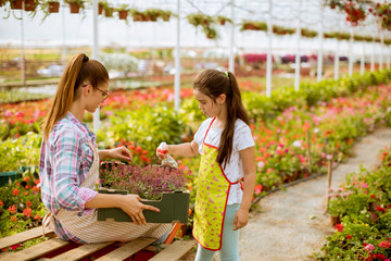 Young  florists enjoying work in the greenhouse