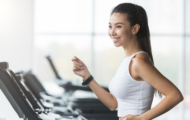 Woman working out, doing cardio exercise in gym