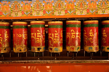 Rotating Prayer wheels with inscriptions on them