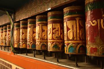 Prayer wheels Tibetan prayer mantras inscribed on it