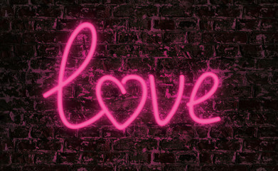 Love word neon text on grunge wall background