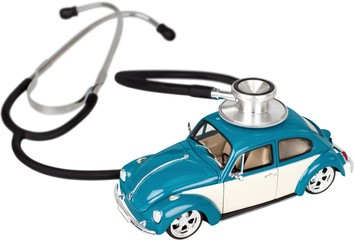 Stethoscope on a car - car maintenance