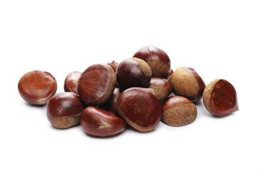 Fototapeta Pile edible chestnut isolated on white background obraz