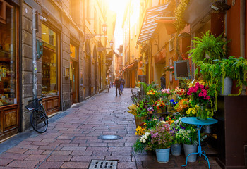 Old narrow street with flower shop in Bologna, Emilia Romagna, Italy