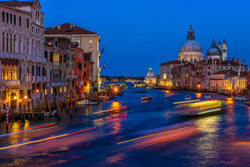 Grand Canal with Basilica di Santa Maria della Salute in Venice, Italy. Night view of Venice Grand Canal. Architecture and landmarks of Venice. Venice postcard