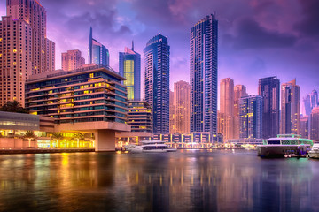Beautiful view to Dubai Marina Promenade, UAE. Long exposure and HDR effect in the dusk