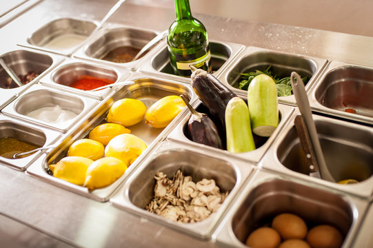 Tray with cooked food on showcase at cafeteria