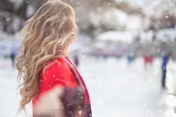 Image of unrecognizable girl ice skating at ice rink, outdoor