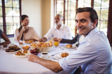 Businessman looking at camera in restaurant