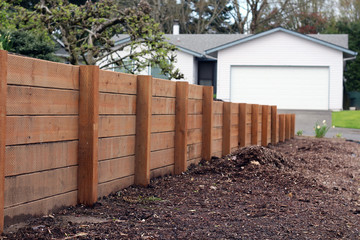 Horizontal sturdy retaining wall in yard for erosion and separation