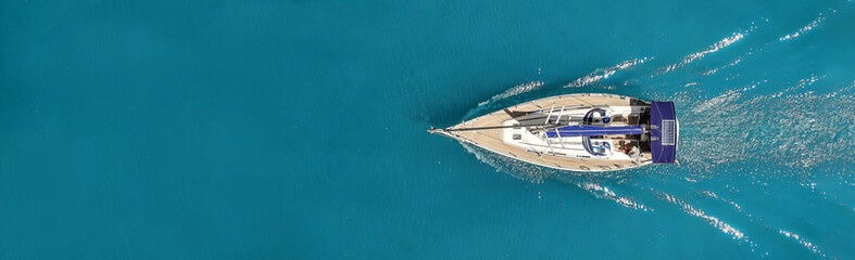 Beautiful photo of the yacht from above in the open sea.