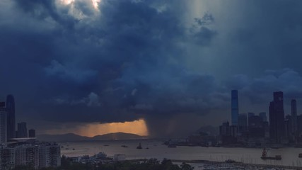 Fotomurales - Victoria harbor of Hong Kong Island with sunny stormy sky, China