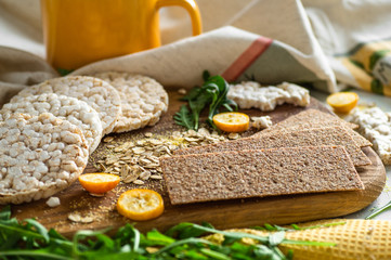 Round crispy rice crackers and Rye Crackers whith kumquat. Dietary concept and healthy vegetarian food.