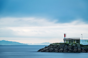 Cliffs and small lighthouse in Pontevedra, Spain