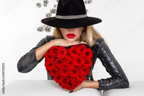 230146db0475d Valentine Beauty girl with red heart roses. Portrait of a young female  model with gift