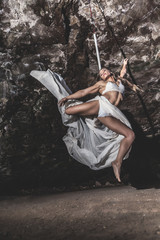 Young woman practicing pole dance