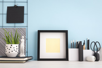 Frame mock up on blue wall