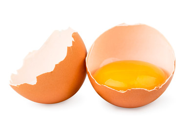 Two halves of chicken egg close up on a white. Isolated.