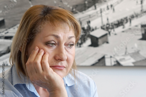 A lonely elderly woman, she is depressed and separated from