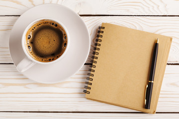 Blank open notebook with coffee cup, Business template mock up for adding your text. Business still...