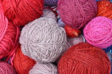 Color yarn for knitting, knitting wool balls . Beautiful yarn knitting background. Close up of multi colored kitting yarn.