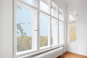 big wooden windows in apartment room of old building Wall mural