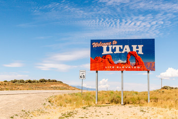 Utah state line sign off the highway