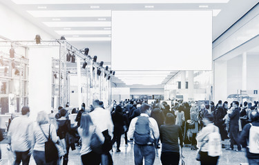 blurred business people at a trade fair, copyspace for your individual text