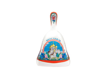 ceramic souvenir toy in the form of bell with beautiful color painting on isolated white background reflecting the national Russian culture with the inscription in Russian: city name Yaroslavl