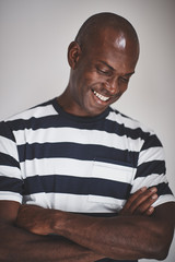African entrepreneur smiling while standing against a gray backg