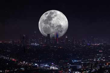 Fotomurales - Beautiful night aerial view of Los Angeles, California, USA, with downtown district and a full moon above the city.