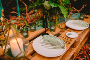 Wedding table, cutlery, candles and floristic. Wedding rustic dinner