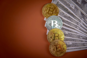 Bitcoin on a pile of money, american dollar bills
