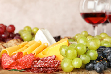 Different snacks and blurred glasses of wine on background