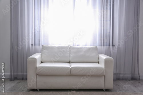 Simple Living Room Interior With Comfortable Sofa Near Window Space