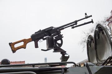 machine gun on an armored carrier