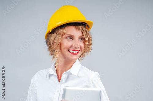 76bb2b22da5 Business woman engineer in yellow safety helmet with tablet