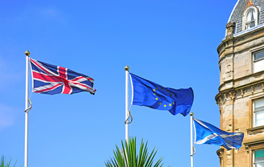 View of a Scottish, British and European Union flag in Oban, Scotland