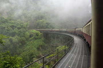 Kuranda train going over a bridge in the rainforest near Cairns, Australia