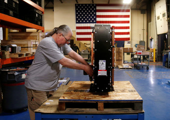 Receiving and shipping worker Mike Pawloski prepares to ship a newly assembled transformer to a client in the RoMan Manufacturing plant in Grand Rapids, Michigan