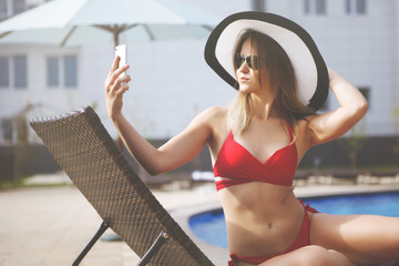 Young pretty woman in a red swimsuit