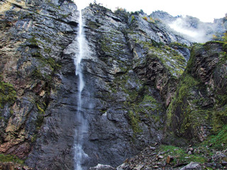 Tscholbodenfall waterfall in the Klontal valley and next to Lake Klontalersee - Canton of Glarus, Switzerland