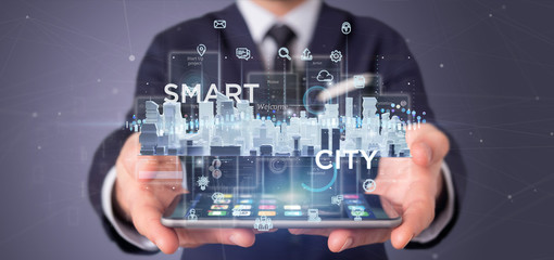 Businessman holding Smart city user interface with icon, stats and data 3d rendering