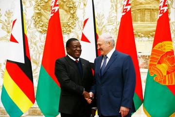 Belarussian President Lukashenko shakes hands with Zimbabwe's President Mnangagwa in Minsk