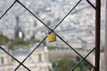 padlock of lovers hanging on the Eiffel tower