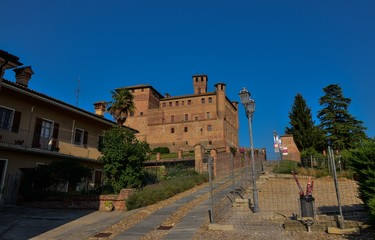 Grinzane Cavour, Piedmont, Italy. July 2018. The majestic castle made of red bricks.