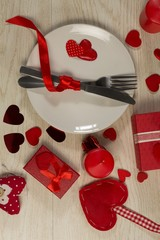 Gift boxes and heart shape decorations with cutlery