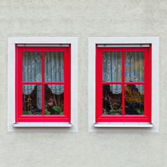 Christmas decorated house windows with red frame, Germany