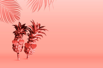 Summer tropical concept design of Pineapples wearing sunglasses on Pantone Color of the Year 2019 Living Coral