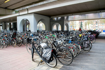 Parking of bicycles in Amsterdam, Netherlands. Selective focus